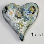 small ceramic heart decorated with slips, engobe and ceramic crayons and pencils